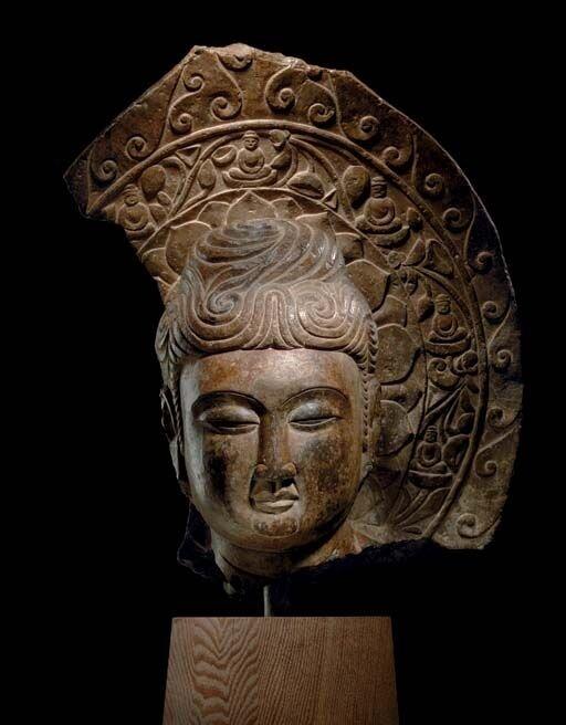 A_rare_dark_grey_stone_head_of_Buddha__Tang_dynasty__618_907_