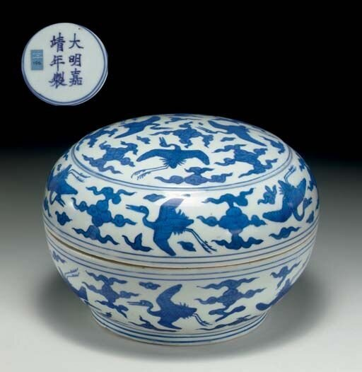 A_rare_blue_and_white_circular_box_and_cover__Jiajing_six_character_mark_in_underglaze_blue_within_a_double_circle_and_of_the_period__1522_1566_