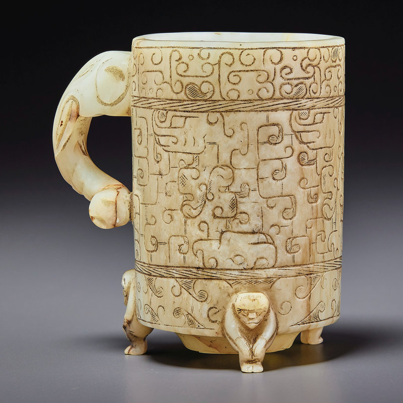 A pale greenish-grey jade archaistic footed cup, zhi, Ming dynasty