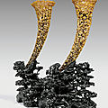 A pair of large reticulated rhinoceros horn libation cups, 19th century