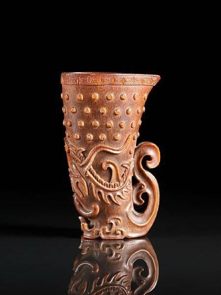 A fine and rare rhyton-form 'dragon' rhinoceros horn libation cup. 17th-18th century. photo Bonhams