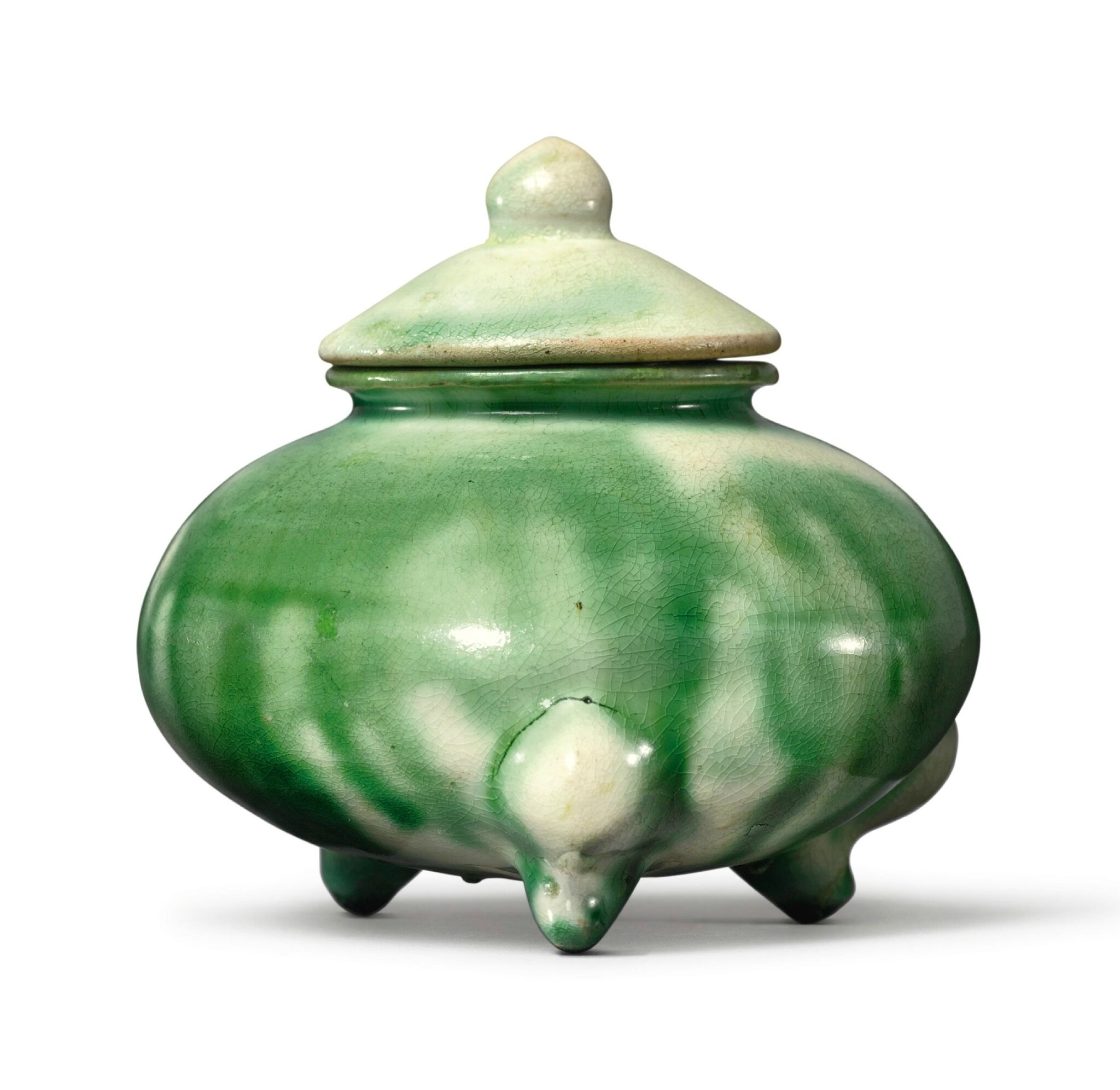 A small green-splashed pottery tripod censer and cover, Tang dynasty