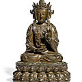 A large and finely-cast inscribed bronze figure of avalokitesvara, ming dynasty (1368-1644)