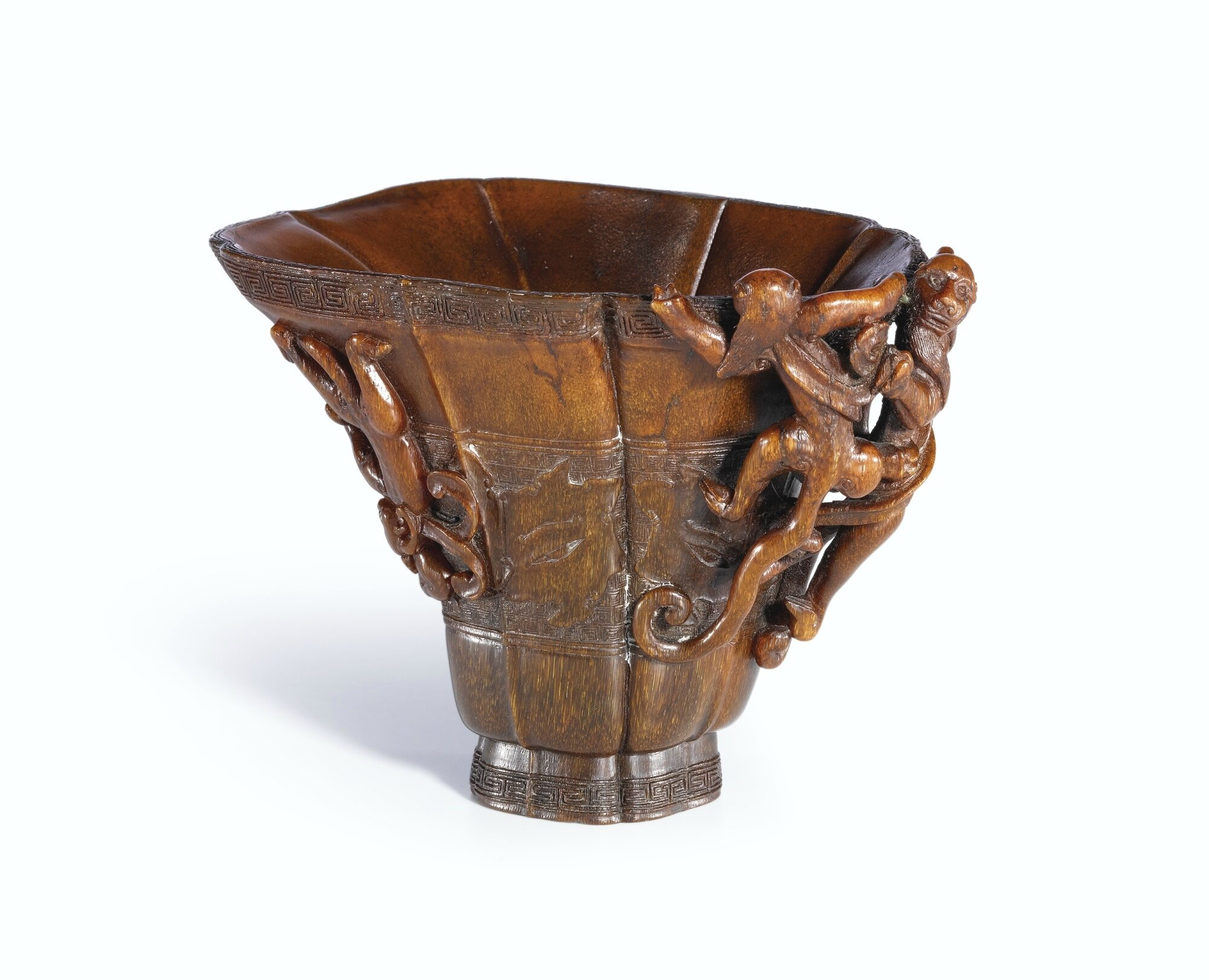 A carved rhinoceros horn archaistic 'Five Chilong' libation cup, 17th century