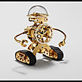 mb et f sherman horloge robot plaquee or et diamants