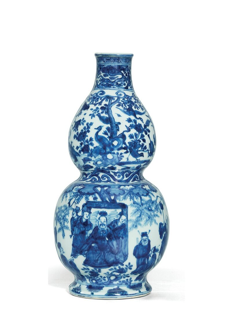 A rare late Ming blue and white double-gourd wall-vase, Wanli six-character mark in underglaze blue and of the period (1573-1609)