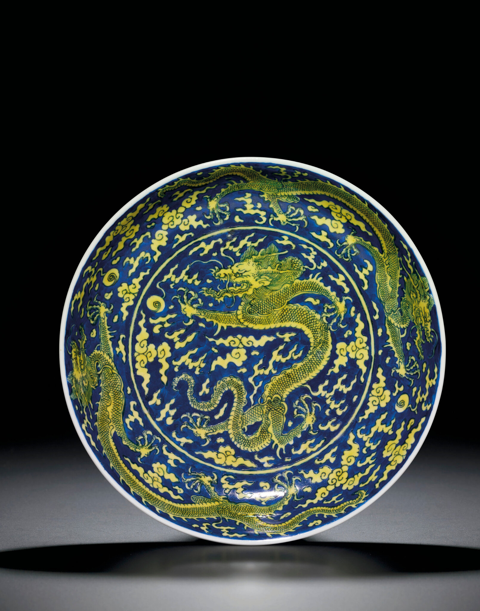 An underglaze-blue and yellow-enamelled 'Dragon' dish, Kangxi six-character mark within double circles and of the period (1662-1722)