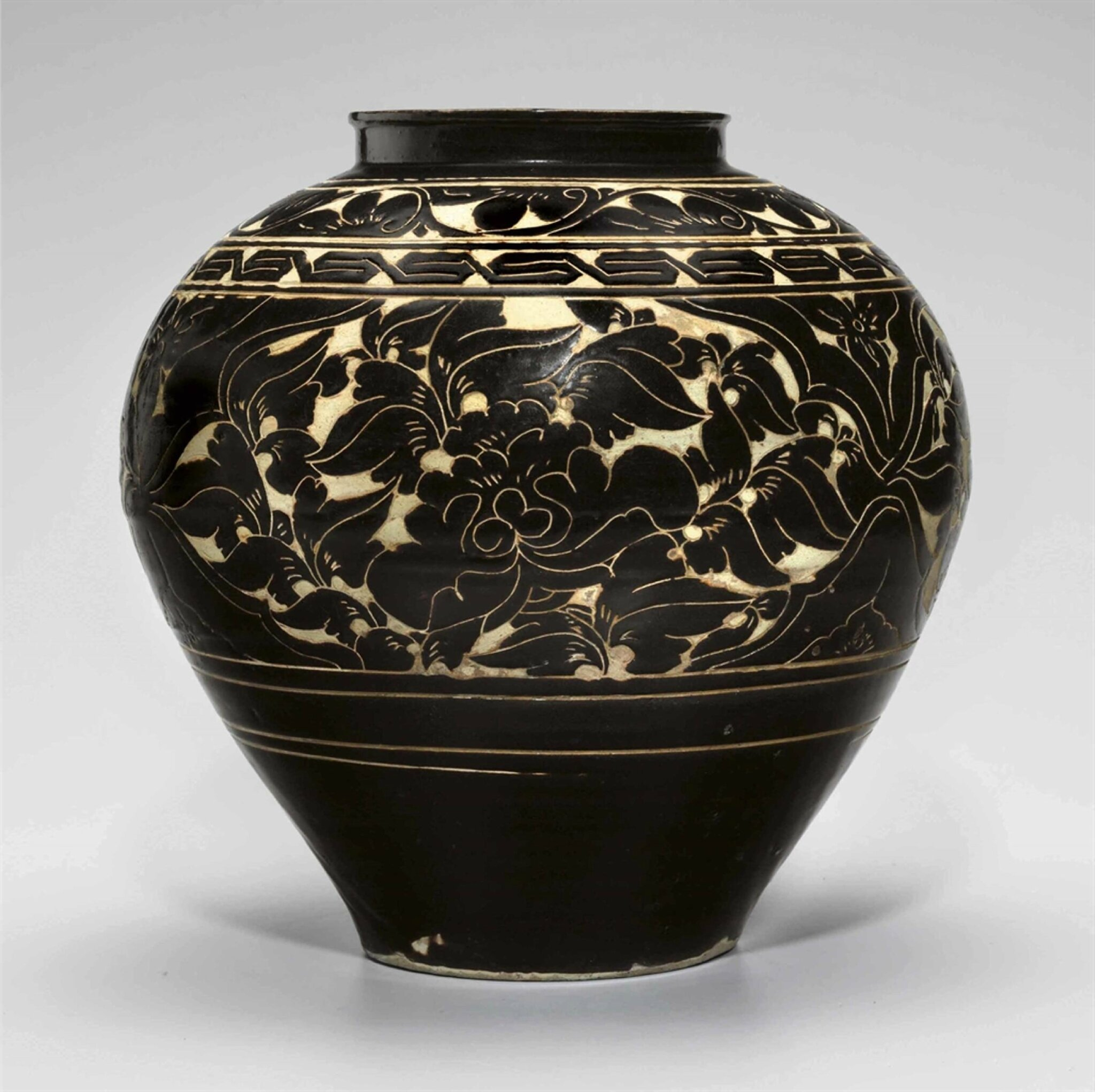 A large blackish-brown cut-glazed jar, Jin-Yuan dynasty, 13th-14th century