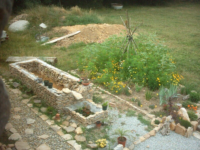 Construction d 39 un bassin fontaine photos et commentaires for Construction bassin de jardin