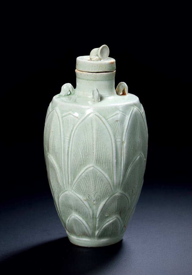 A Rare Small 'Yueyao' 'Lotus-Bud' Carved Slender Baluster Jar and Cover, Five Dynasties, 10th Century