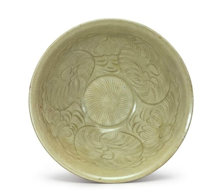 A carved 'Yaozhou' celadon-glazed bowl, Northern Song dynasty (960–1127)