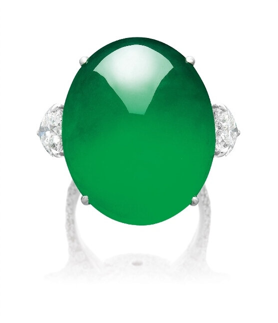 An Impressive and Fine Type A Jadeite Cabochon and Diamond Ring