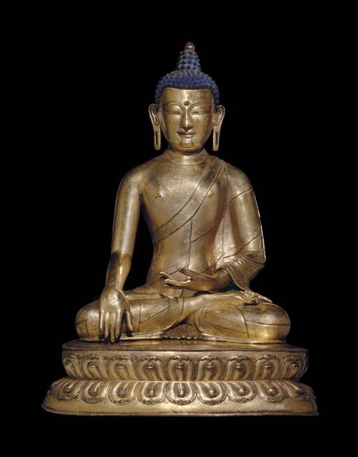 A large gilt bronze figure of Buddha Tibet, 15th century