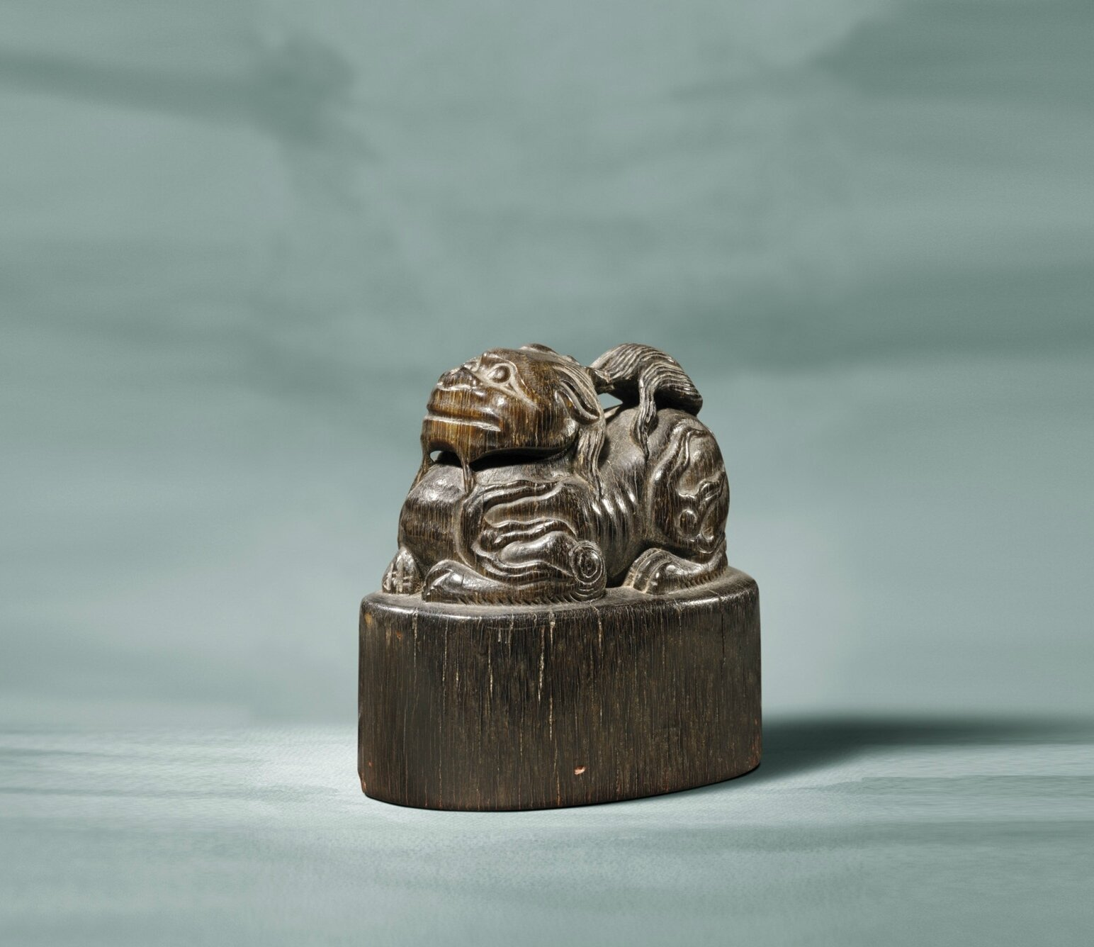 A rhinoceros horn seal with a xiezhi finial, Ming dynasty, 16th-17th century