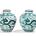 Two green-enamelled 'dragon' jars and covers, qianlong seal marks and period (1736-1795)