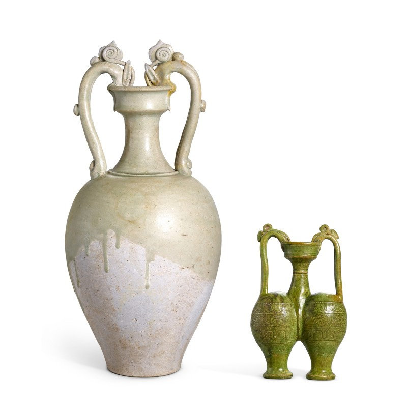 A green-glazed conjoined dragon-handled amphora, Sui dynasty, and a celadon-glazed dragon-handled amphora, Tang dynasty