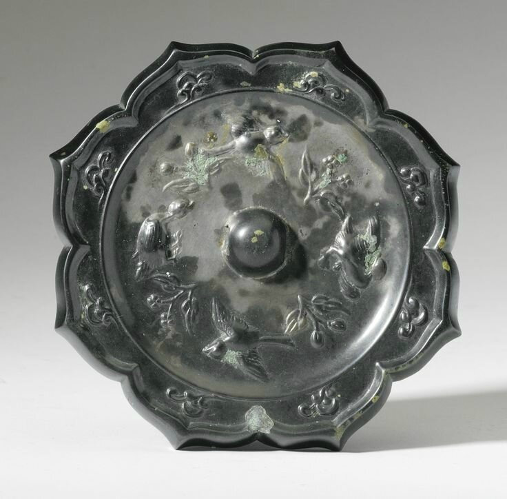 A bronze 'Bird and Flower' octafoil mirror, Tang Dynasty