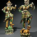 An exceptional pair of massivesancai-glazed pottery guardian figures, tang dynasty (ad 618-907)