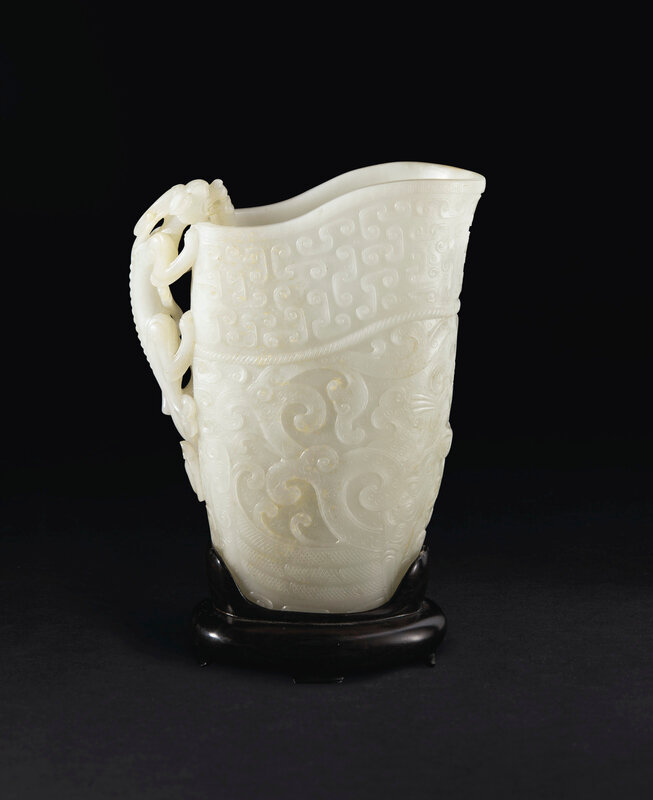 2019_NYR_17836_0804_001(a_finely_carved_white_jade_archaistic_rhyton_china_qing_dynasty_17th-1)