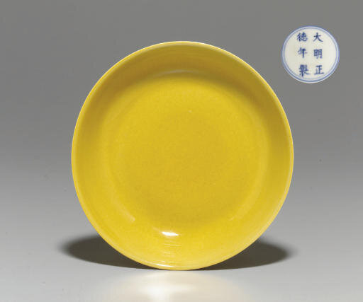 An Imperial yellow-glazed saucer dish, Zhengde six-character mark in underglaze blue within a double circle and of the period (1506-1521)