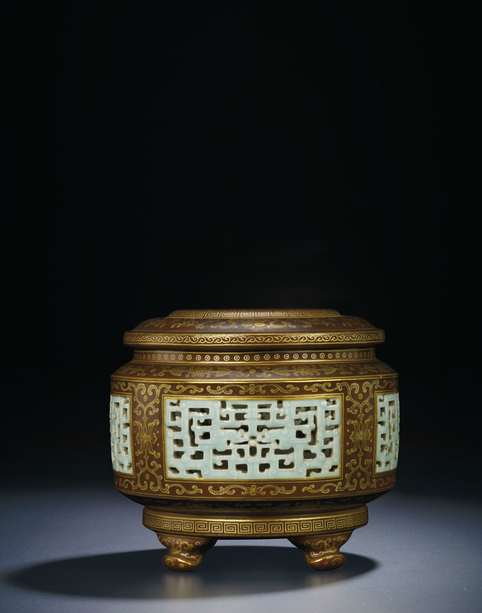 A very rare gilt-decorated 'imitation bronze' reticulated censer, Qianlong gilt six-character seal mark and of the period (1736-1795)