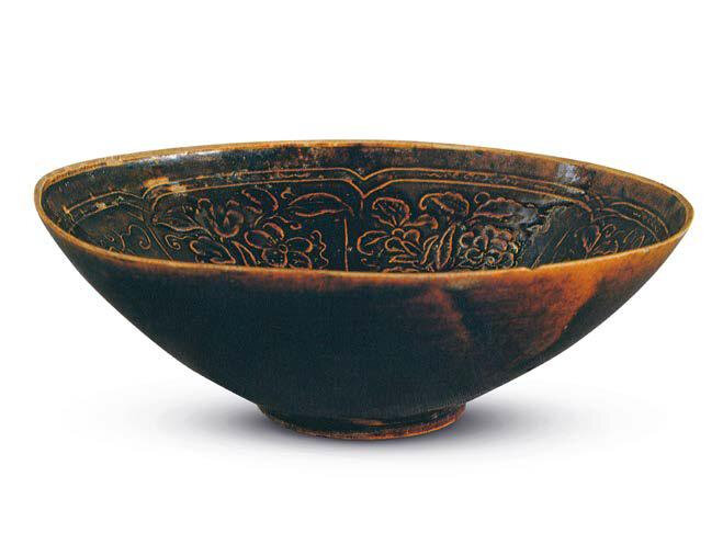 A brown-glazed Ding bowl with a floral roundel in the centre, excavated at Zhelimu Naiman Mengqi in 1975, in the Collection of Jilin Provincial Museum
