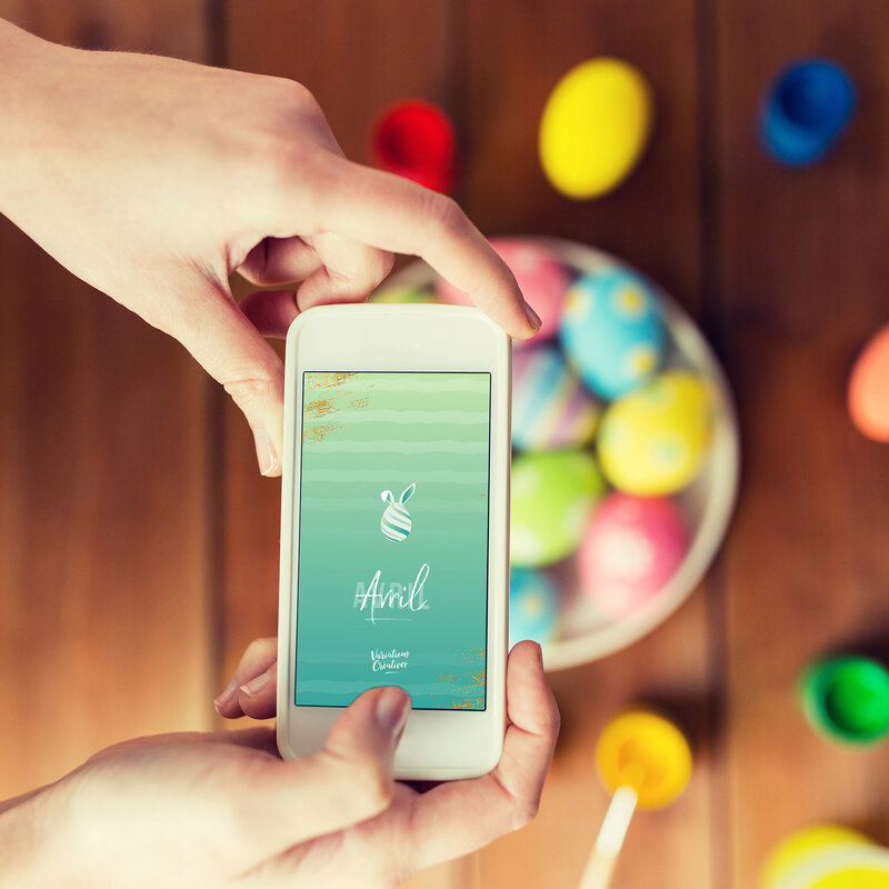 close-up-of-hands-with-easter-eggs-and-smartphone-PAXK3YU