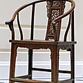 A rare ornately carved huanghuali horseshoe-back armchair, 17th-18th century