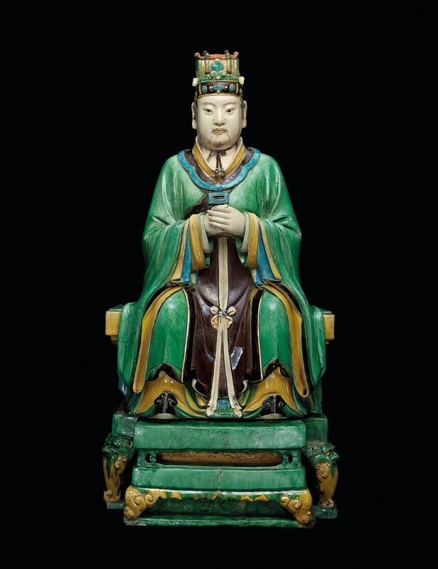 A magnificent polychrome-enamelled model of a celestial official, Ming dynasty (1368-1644)