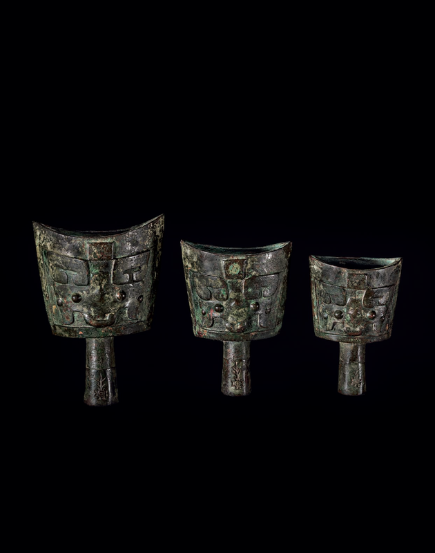 A rare set of three small bronze bells, nao, late Shang dynasty, 13th-11th century BC