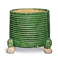 A small green and yellow-glazed cylindrical tripod censer, Tang dynasty (AD 618-907)