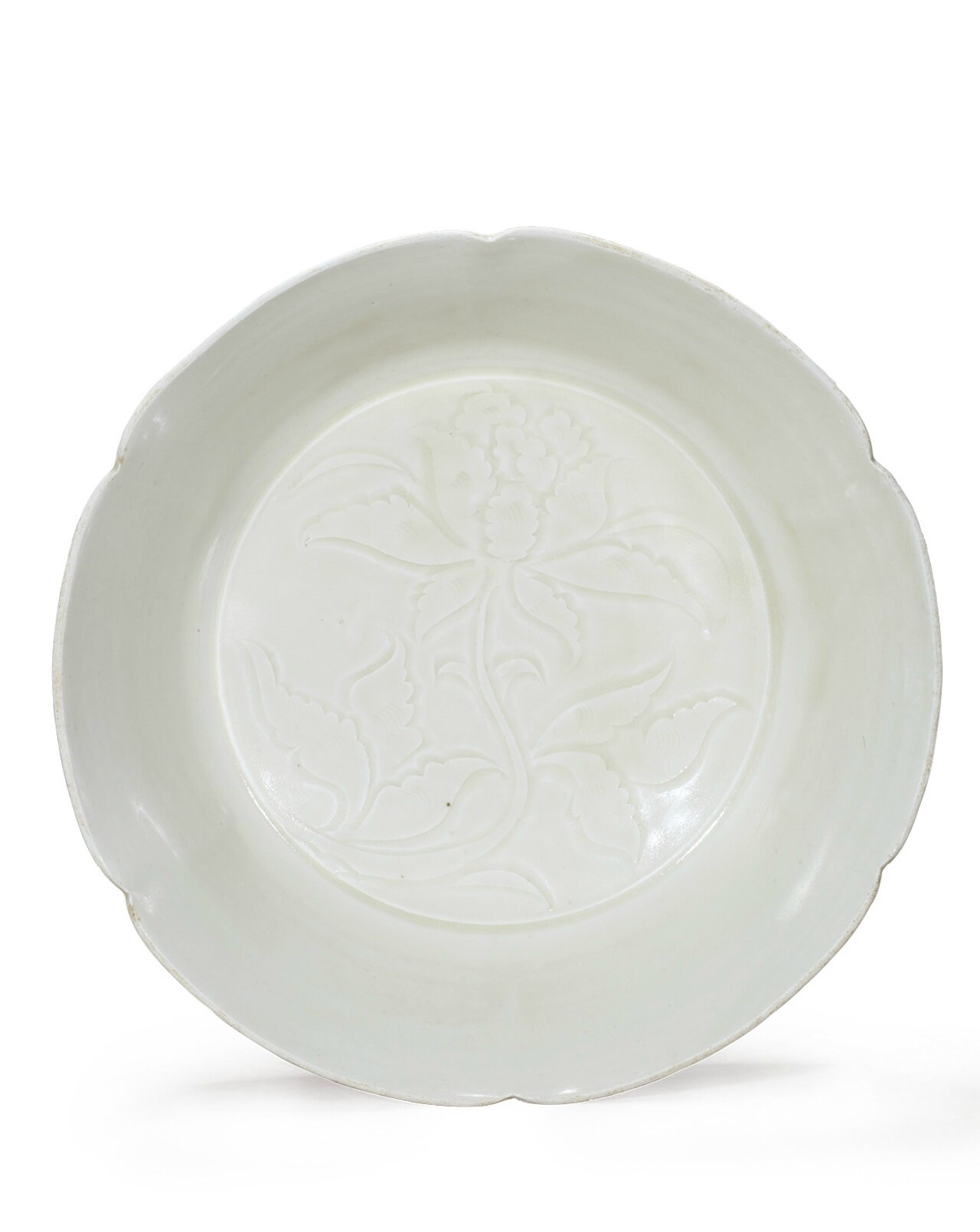 A rare Dingyao white glazed floral bowl carved with hibiscus pattern, Song Dynasty