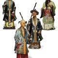 A group of four chinese export polychrome-decorated clay and papier-mâché 'nodding head' figures, 19th century