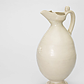 A rare white-glazed ovoid ewer, tang dynasty (618-907)
