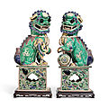 A pair of famille verte biscuit-glazed buddhist lions, kangxi peiod (1662-1722)