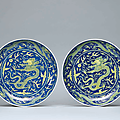 A pair of blue-ground yellow-enamelled 'Dragon' dishes, Daoguang six-character seal marks in underglaze blue and of the period (1821-1850)