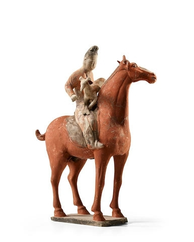 A Painted Pottery Figure Of A Horse And Rider With Hound