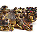 A rare gilt-bronze 'mythical beast' waterdropper, mark and period of xuande(1426-1435)