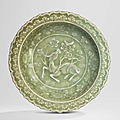 A longquan celadon moulded 'rhinoceros' dish, yuan-early ming dynasty, 14th century