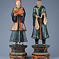 A fine pair of large glazed stoneware standing figures, 16th century