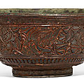 A rare carved red and black lacquer 'phoenix' bowl, song dynasty (960-1279)