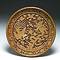 Carved yellow lacquerware round dish with dragon-and-phoenix décor, ming dynasty, jiajing reign (1522-1566)
