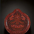 A large and impressive cinnabar lacquer 'chun' peach-shaped box and cover, qing dynasty, qianlong period (1736-1795)