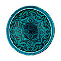 a kashan turquoise-blue glazed pottery bowl, central iran, 12th century