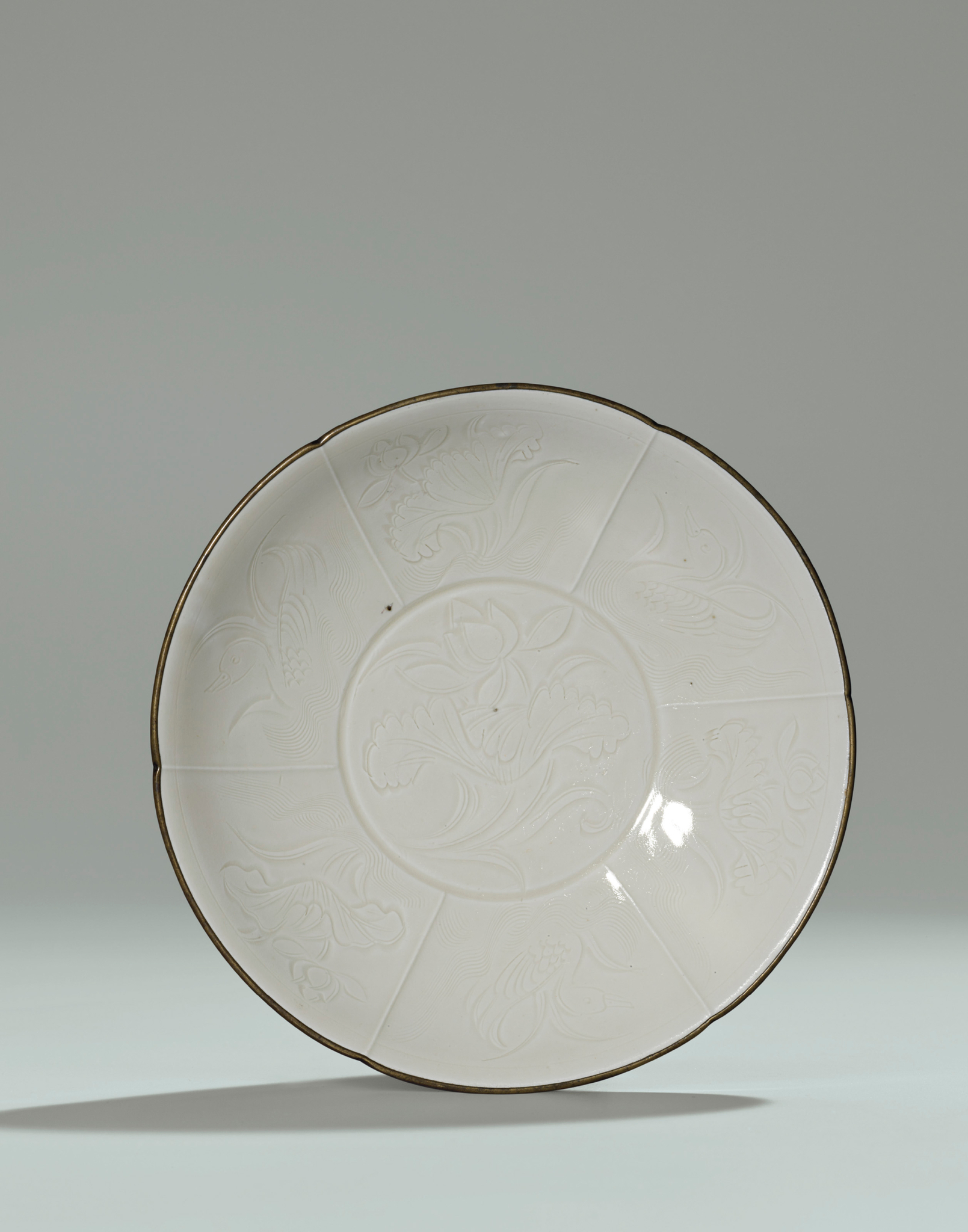 An important fine and rare Ding floral-lobed shallow bowl , Northern Song Dynasty (960-1127)