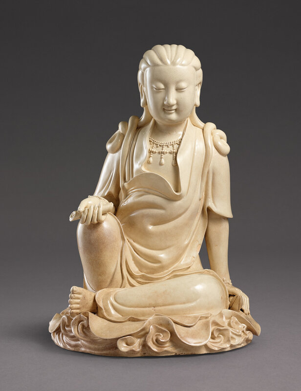 A large inscribed Zhangzhou crackle-glazed figure of Guanyin, Ming dynasty, Wanli period, dated 1615