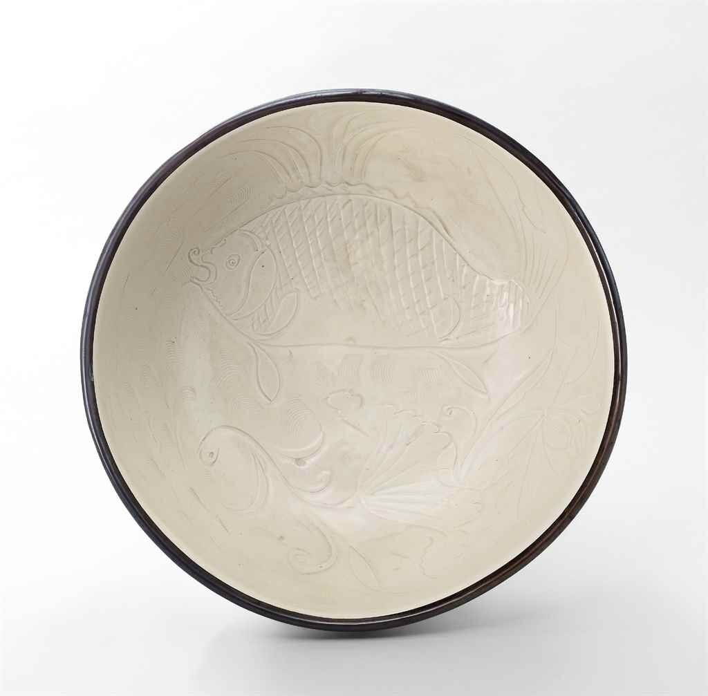A large Ding carved 'Fish' bowl, Northern Song dynasty (960-1127)