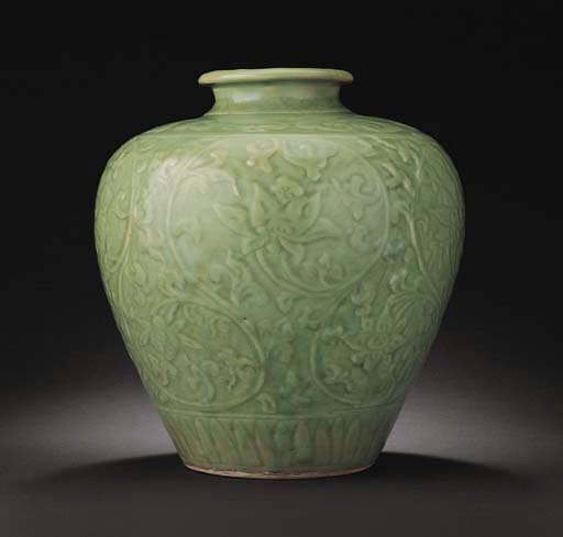 A rare carved and moulded Longquan celadon baluster jar, Ming dynasty, 15th century