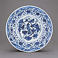 A fine and superb early ming blue and white 'grapes' dish, yongle period (1426-1435)