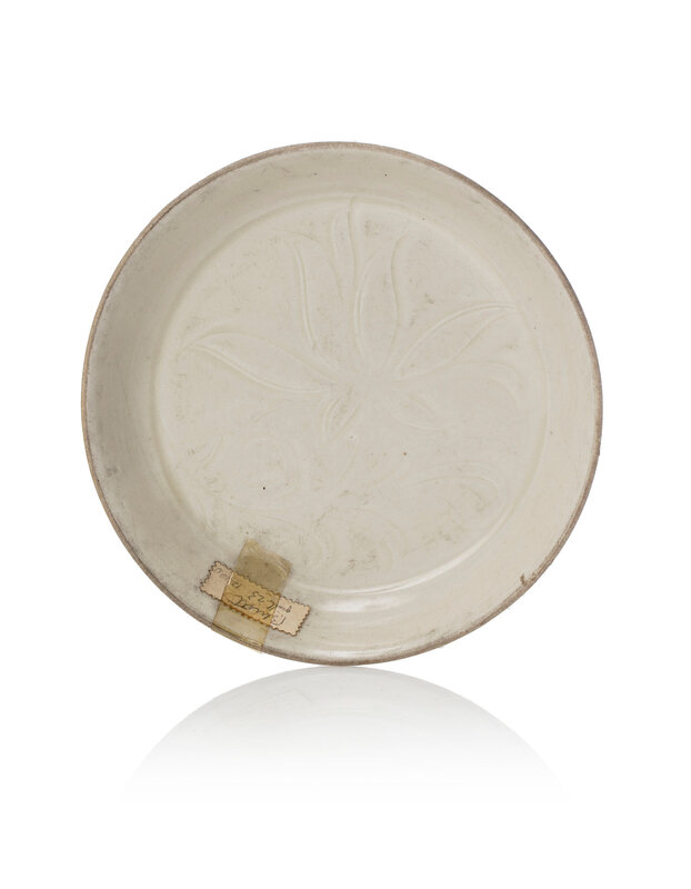 A Dingyao dish incised with a peony flower inside, Song dynasty (960-1279)